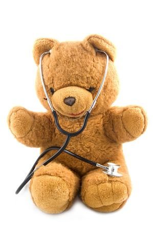 Bown teddybear acting as a doctor with a stetoscope isolated on white