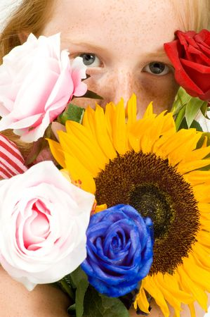 girl is holding lots of flowers Stock Photo - 5233487