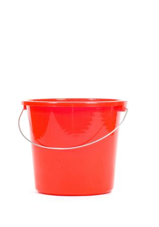 red bucket isolated on a white background photo