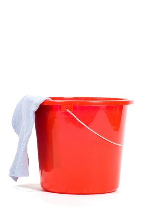 dishcloth: red bucket with dishcloth  isolated on white Stock Photo