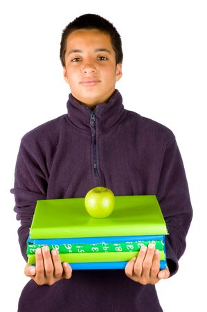 carying: pakistan schoolboy is carying schoolbooks and an apple on white