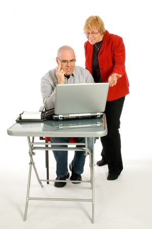assistent: CEO is showing assistent the good work on white Stock Photo