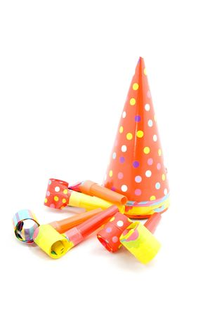 colorful partyhats and party whistles isolated on white