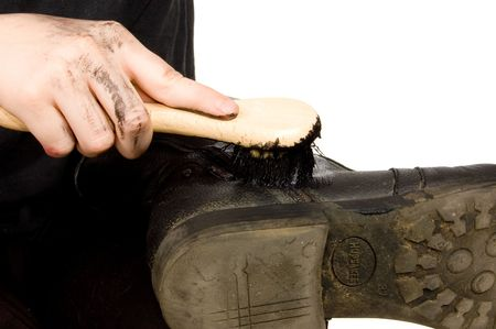 bootblack is doing black boots on white