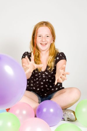 young girl playing with balloons isolated Stock Photo - 5803321