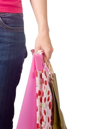 Image of female holding shoppingbags in her hand isolated on white  photo