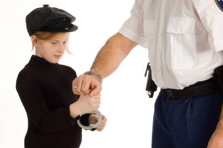 little girl is learning how to arrest a person photo
