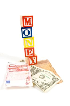 valuta: valuta different countries with money on wooden blocks over white