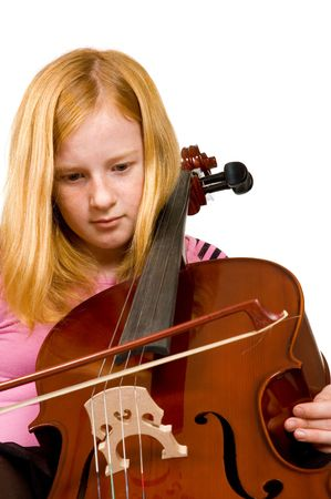 Young girl playing cello isolated on a white background Stock Photo - 6035293