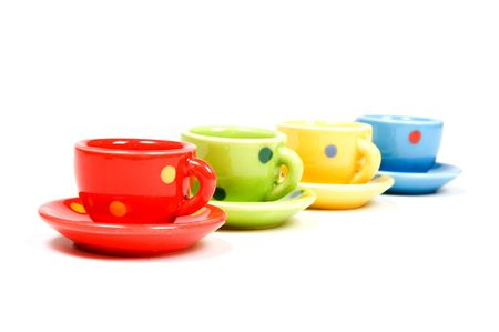 speckles: speckles cups and saucers isolated over white