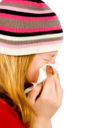 Young red girl blowing her nose - isolated on white