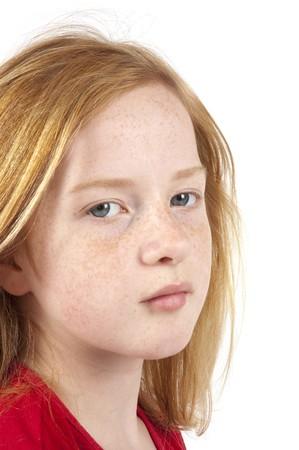 sad looking redhead girl on white
