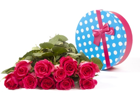 giftbox with pink roses in front isolated on white