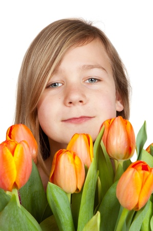 cute young girl is holding a bunch of tulips Stock Photo