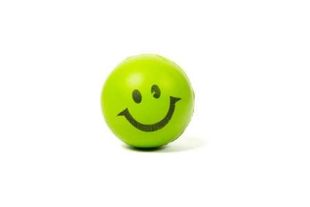 green smiley ball isolated on white photo