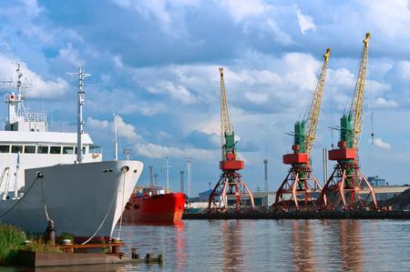 unloading: harbour crane, port crane, marine loading and unloading logistics terminal port