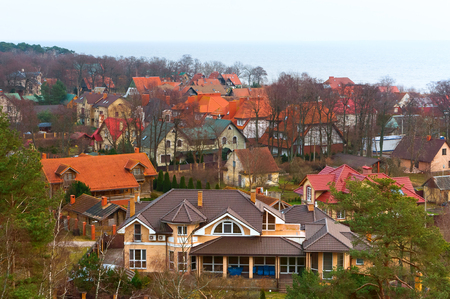 the village on the Bay, views of the village from above, multi-colored roofs