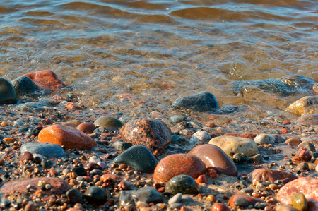 stones of different size and color, sea stones, big and small stones from the sea