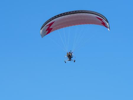 paraglider, glider pilot with motor, paragliding