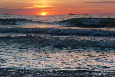 sunset on the Baltic sea, beautiful sunrise and waves on the sea Stock Photo