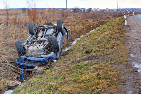 car crash, blue car overturned on the road transport traffic accident Stock Photo