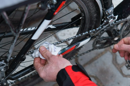 to take care of the bike, to lubricate parts and clean, maintenance of the Bicycle 스톡 콘텐츠