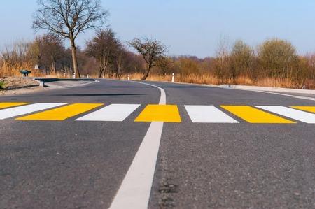 white yellow markings on the road, pedestrian crossing outside the city Zdjęcie Seryjne - 122927740