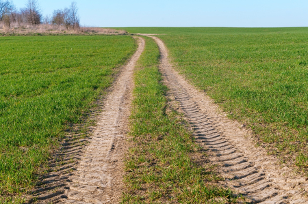 the trace of the tractor, dry soil in the field