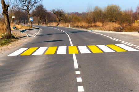 pedestrian crossing outside the city, white yellow marking of pedestrian crossings