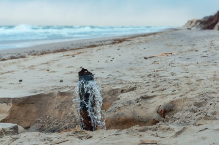 water from sewer pipe, wastewater on the seashore Stockfoto