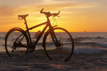 the silhouette of a Bicycle on the beach, Bicycle at sunset