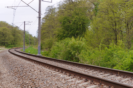railway stretching into the distance, rails in three rows
