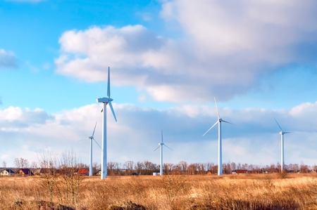 wind farm in the field, freshly plowed field, agricultural land and wind turbines