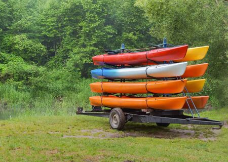 on the trailer with eight canoes, kayaks by car delivered to the river