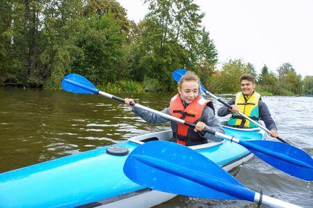 young people rafting on the river, kayaking on a calm river, Matrosovka river, Slavsky district, Kaliningrad region, Russia, September 21, 2019