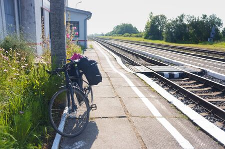 tourist Bicycle at railway station, cyclist waiting for train, Kaliningrad region, Russia, August 3, 2019