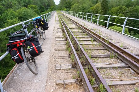 two bicycles on an abandoned railway, bicycles with bags on the journey, Kaliningrad region, Russia, August 3, 2019