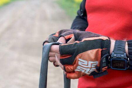 a man seals a Bicycle camera, Bicycle tire strap, Kaliningrad region, Russia, may 19, 2019