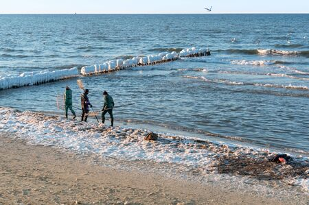 private amber fishing, amber catchers in the sea, Kaliningrad region, Russia, Baltic sea, 18 March 2018