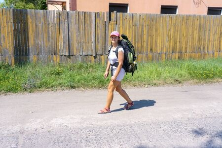 girl with tourist backpack, girl going camping, Kaliningrad region, Russia, July 20, 2019