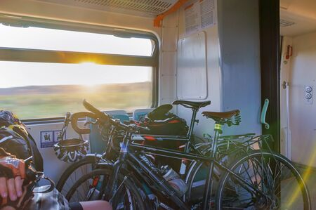bicycles in an electric train carriage, cyclists in a train, Kaliningrad region, Russia, July 28, 2019
