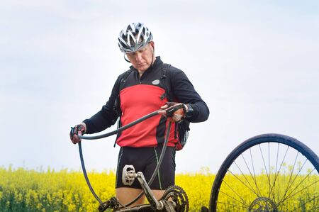 a man repairs a Bicycle, a Bicycle wheel puncture, Kaliningrad region, Russia, may 19, 2019 報道画像