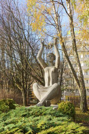 Sculpture of a girl with her hands raised to the sky, plaster sculpture of a woman, Svetlogorsk, sanatorium Amber coast, Kaliningrad region, Russia, November 17, 2019