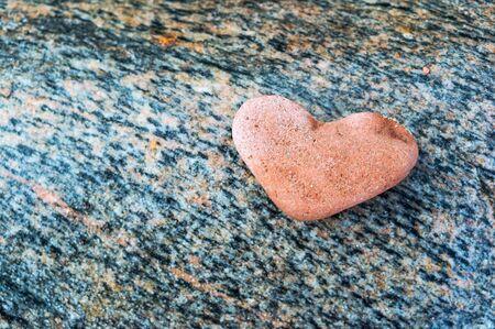 heart-shaped stone, sea pink stone heart