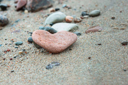 sea stone in the shape of a heart, a heart of stone