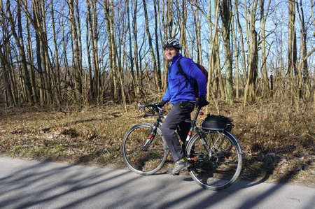 a man in a helmet on a Bicycle, a cyclist in a blue jacket, Kaliningrad, Russia, March 15, 2020