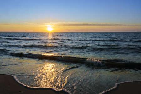 the sun going below the horizon of the sea, sunset on the sea coast Stock fotó