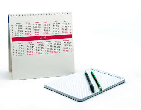 Notepad and calendar 2021, pen and pencil and with a Notepad on a white background