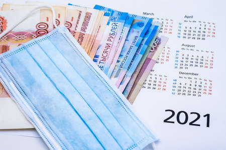 fabric mask and Russian money, medical mask and calendar 2021, mask on calendar 2021