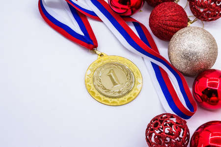 winter competitions, new year's holiday, sport medal and red Christmas balls, sports award and Christmas toys